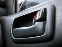 Poignée de porte dans la voiture Images stock