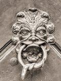Poignée de porte de vintage avec le visage Photos stock