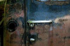 Poignée de porte et réservoir de gaz Image libre de droits