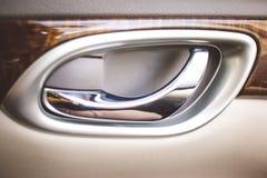 Poignée de portière de voiture intérieure Photos stock