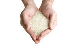 Poignée de riz d'isolement avec   Photo stock