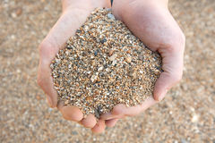 Poignée de sable brut Images libres de droits