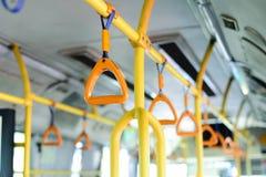 poignée jaune d'autobus Photos libres de droits