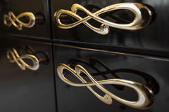 Poignées de meubles de courbes Photographie stock