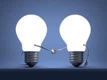 Poignée de main rougeoyante d'ampoules sur le bleu Photos stock