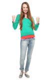 Poings de serrage Excited de jeune femme Photos stock