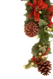 Poinsettia and christmas decoration side border Royalty Free Stock Photography