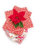Poinsettia and Christmas present boxes Stock Photos