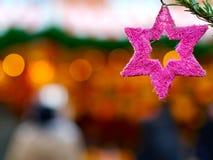 Poinsettia christmas tree branch pink star Stock Photo