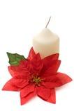 Poinsettia con la candela gialla Fotografie Stock