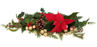 Poinsettia Floral Decoration. Christmas decorative floral arrangement of a poinsettia flower, holly, mistletoe, ivy, cedar cypress leaf sprigs, pine cones and Stock Photography