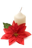 Poinsettia with yellow candle Stock Photos