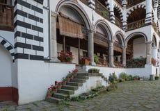 Geranium-lined steps and balconies, Rila Monastery, Bulgaria stock photo