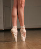 On point. Closeup of ballerina in a point Royalty Free Stock Photography