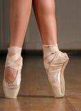 On a point. Closeup of a ballerina's feet on a point royalty free stock photos
