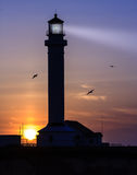 Point Arena, California. The sun sets on Point Arean lighthouse in California Royalty Free Stock Photo