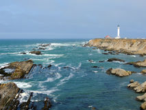 Point Arena Light House. On the California coast continues to alert ships to the rocks at its base stock images