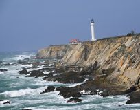Point Arena Lighthouse. With splashing surf, Pacific Ocean, California, USA Stock Photography