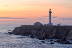 Point Arena Lighthouse at sunset, California. Point Arena Lighthouse on the rock, California, USA royalty free stock photo