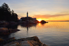 Point Atkinson Lighthouse at sunrise Stock Image