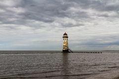 Point of Ayr Lighthouse. Point of Ayr derelict lighthouse, on the most northern tip of Wales. Talacre, Flintshire, United Kingdom royalty free stock photos