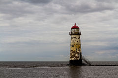 Point of Ayr Lighthouse. Point of Ayr derelict lighthouse, on the most northern tip of Wales. Talacre, Flintshire, United Kingdom Stock Photo