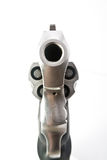 Point Blank. Isolated image of the business end of a loaded revolver Stock Photography