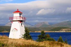 Point boisé de phare Photo libre de droits