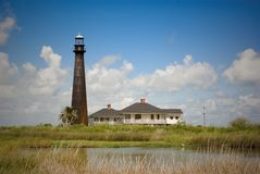 Point Bolivar Lighthouse. Built in 1872, this lighthouse is located on the Bolivar Peninsula (Port Bolivar) of Texas along the Gulf of Mexico. A caretaker's Royalty Free Stock Photography