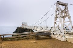 Point Bonita Lighthouse on a foggy day, Marin Headlands, San Francisco bay area, California stock photo