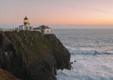 Point Bonita Lighthouse. The Point Bonita Lighthouse is perched over the Pacific Ocean basking in the peach rays of sunset royalty free stock image