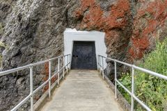 Point Bonita Lighthouse Tunnel Entrance In The Rock. Hand curved tunnel that leads to Point Bonita Lighthouse in Sausalito, Marin Headlands, California, USA royalty free stock image