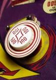 100-point bumper on retro pinball machine Royalty Free Stock Photo