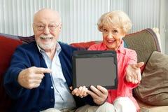 Point d'aînés pour marquer sur tablette le PC Photographie stock