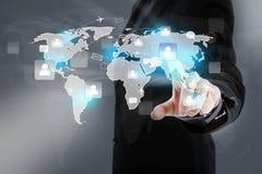 Point de main au réseau et au monde sociaux Image stock