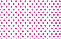 Point de polka rose-foncé avec le fond blanc Photographie stock libre de droits