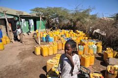 Point of delivery of drinking water. HARGEISA, SOMALIA - JANUARY 11, 2010: One of the largest refugee camps for African refugees and displaced people on the Royalty Free Stock Image