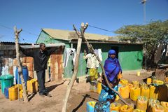 Point of delivery of water in an African refugee camp. HARGEISA, SOMALIA - JANUARY 11, 2010: One of the largest refugee camps for African refugees and displaced Stock Images
