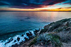 Point Dume State Beach Sunset. Point Dume is a promontory on the coast of Malibu, California that juts out into the Pacific Ocean. The point, a long bluff, forms Stock Photo