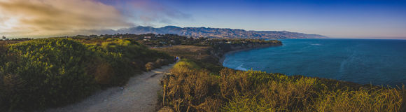 Point Dume Sunset Panorama. Colorful panoramic view of Southern California coast from Point Dume, Malibu during sunset Royalty Free Stock Image