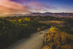 Point Dume Trail. Colorful view of Southern California coast from Point Dume, Malibu during sunset Royalty Free Stock Images