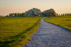 Point of interest near Okotoks, southern Alberta, Canada. Big stone from ice age in the middle of flat meadow royalty free stock images