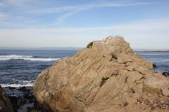 Point Joe, Pebble Beach, 17 Mile Drive, California, USA. Scenic point with large rocks, providing pleasant view of surfing sea, whales and migratory birds Royalty Free Stock Image