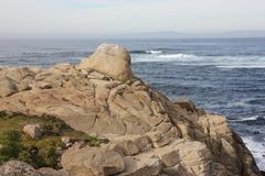 Point Joe, Pebble Beach, 17 Mile Drive, California, USA. Scenic point with large rocks, providing pleasant view of surfing sea, whales and migratory birds Stock Photos