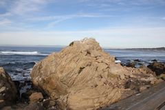 Point Joe, Pebble Beach, 17 Mile Drive, California, USA. Scenic point with large rocks, providing pleasant view of surfing sea, whales and migratory birds Stock Photo