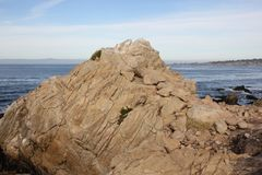 Point Joe, Pebble Beach, 17 Mile Drive, California, USA. Scenic point with large rocks, providing pleasant view of surfing sea, whales and migratory birds Royalty Free Stock Photos