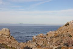 Point Joe, Pebble Beach, 17 Mile Drive, California, USA. Scenic point with large rocks, providing pleasant view of surfing sea, whales and migratory birds Royalty Free Stock Photography