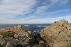 Point Joe, Pebble Beach, 17 Mile Drive, California, USA. Scenic point with large rocks, providing pleasant view of surfing sea, whales and migratory birds Royalty Free Stock Images