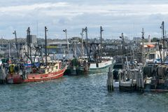 Point Judith, RI / USA - 10/19/2018: Red and Green fishing boats docked at Point Judith, Rhodes Island stock image