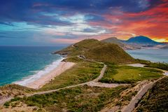 Point of Land in St Kitts. Point of land on St Kitts between caribbean and atlantic ocean stock photo
